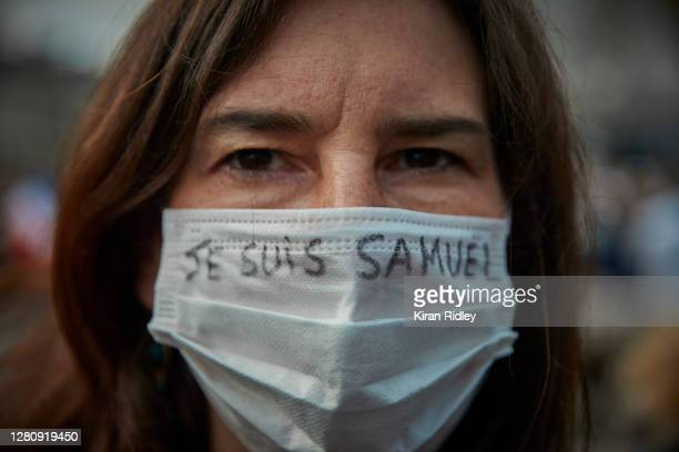 Protestor wears a mask with the slogan 'Je Suis Samuel' written on it during an anti-terrorism vigil at Place de La Republique for the murdered...