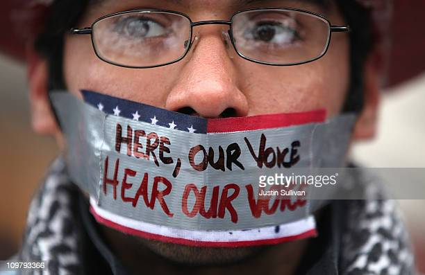 A protestor wears tape over his mouth during a large march and rally at the Wisconsin State Capitol on March 5 2011 in Madison Wisconsin Thousands of...