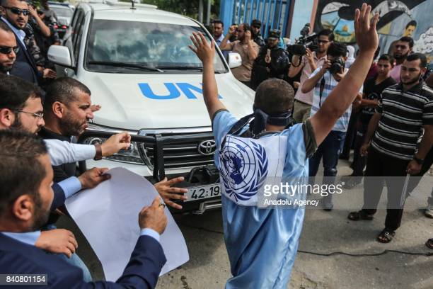 A protestor who is a relative of the Palestinian prisoners held in Israeli jails tries to block the road during a protest against UN SecretaryGeneral...