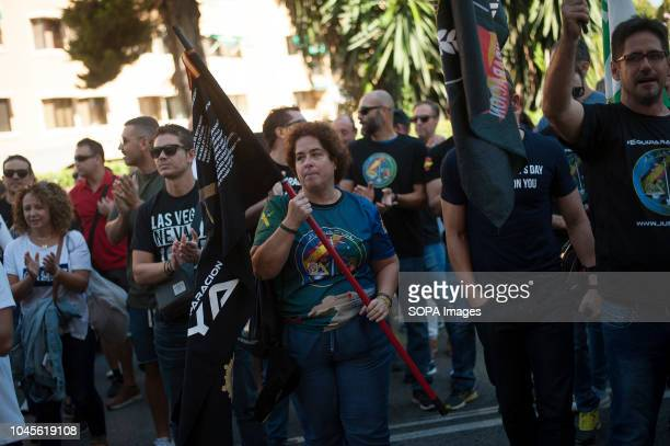 A protestor with a flag takes part in a protest in support of national police officers and civil guards attacked by pro independence protestors...