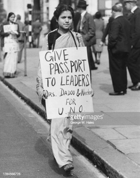 Protestor with a placard reading 'Give Passport to Leaders' during a picket at South Africa House in Trafalgar Square, London, England, 16th...