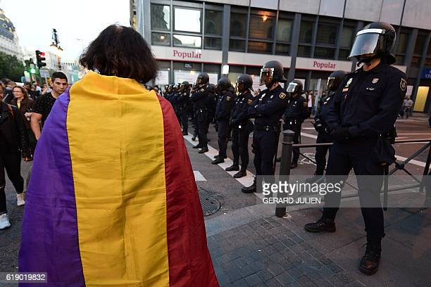 A protestordrapped with a republican flag walks during a demonstration called by the 25S coordinating group and dubbed 'Before the mafia's blow...