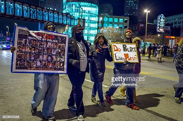 Protestores march on Huron Road on December 29 2015 in Cleveland Ohio Demonstrators took to the street the day after a grand jury declined to indict...