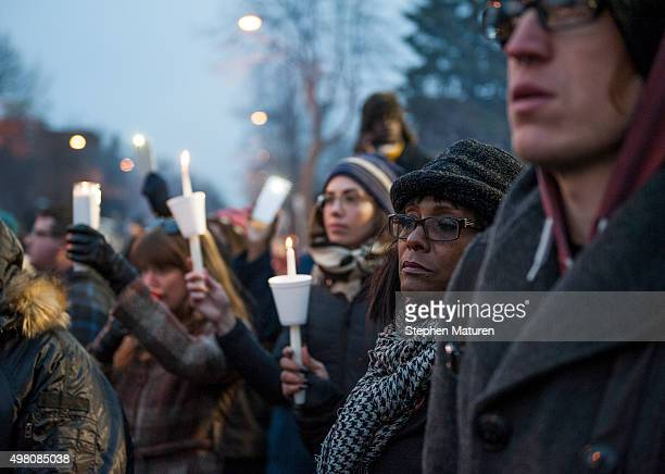 Protestors activists and community members listen to a speech by Nekima LevyPounds Minneapolis NAACP president at a candlelight vigil held for Jamar...