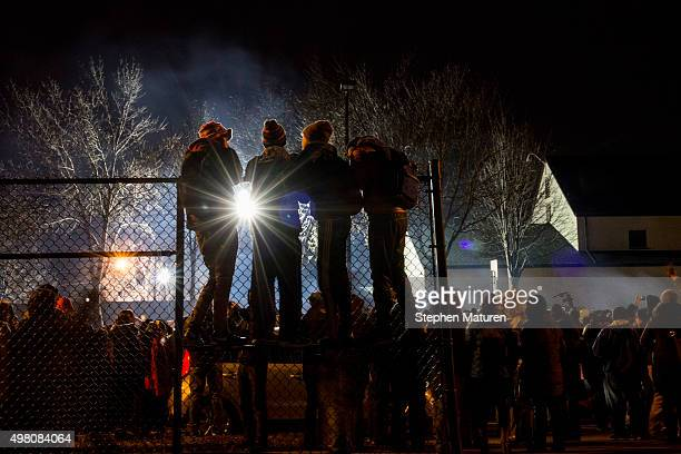 Protestors activists and community members listen to speeches at a candlelight vigil held for Jamar Clark outside the 4th police precinct November 20...