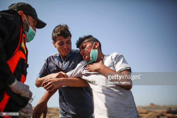 Protestors affected from tear gas try to recover after Israeli security forces' intervention during a demonstration held within the Great March of...