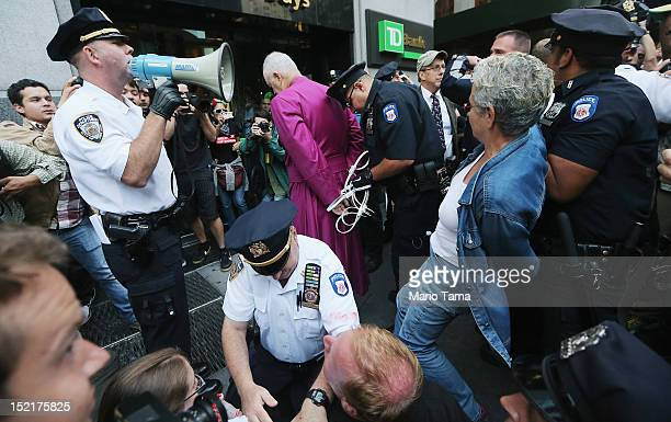 Protestors affiliated with Occupy Wall Street are arrested by NYPD while attempting to form a 'Peoples Wall' to block Wall Street on September 17,...
