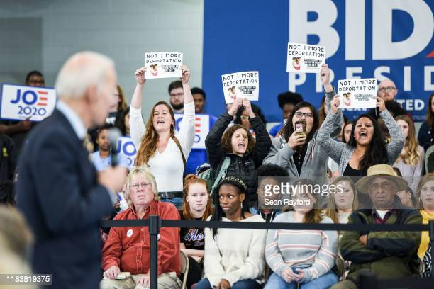 Protestors against deportations interrupt Democratic presidential candidate, former vice President Joe Biden during a town hall on November 21, 2019...