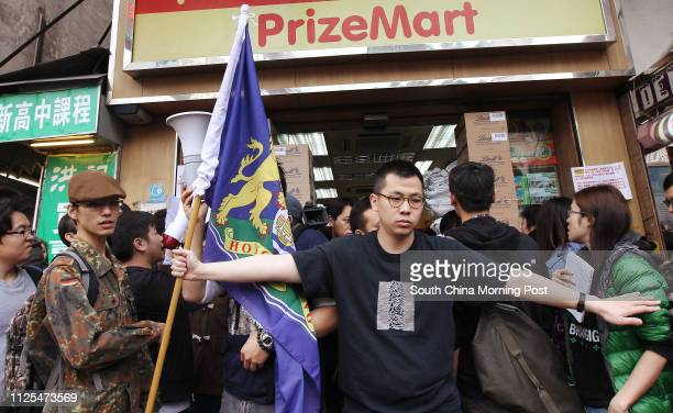 Protestors against parallel traders confront shoppers whom they suspect are mainlanders outside a PrizeMart store in Mong Kok 27JAN13