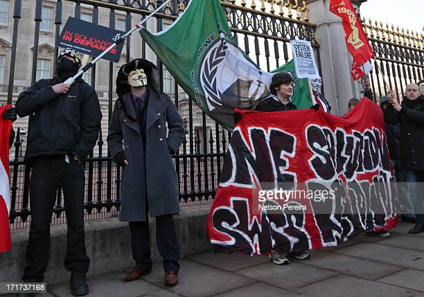 Protestors against the anti-piracy proposals ACTA, marched from the British Music House across major sites in London, here they are seen outside...