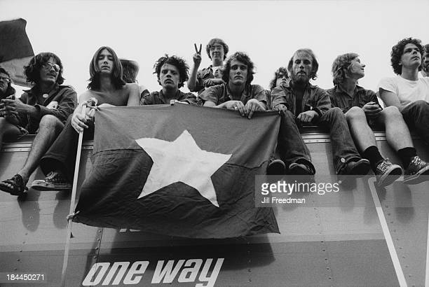 Protestors against the Vietnam War hold a Vietnamese flag in New York City 1972