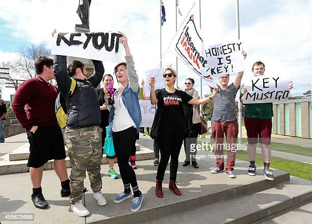 Protestors and an Internet Mana supporter make their voices heard to Prime Minister John Key during a walkabout for the twoday National Party Bus...