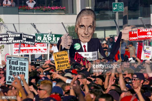 Protestors and fans attend a concert by Rage Against the Machine at the designated protest site at the Democratic National Convention in Los Angeles...