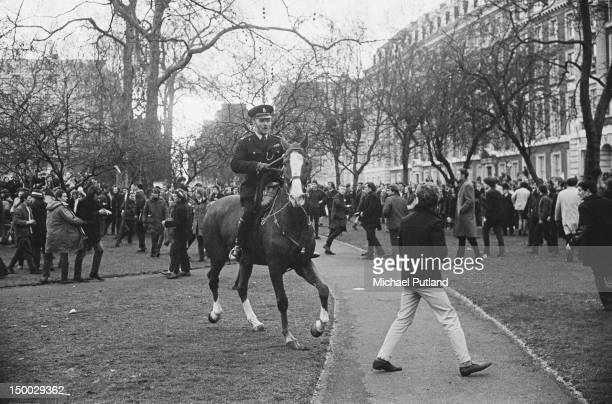 Protestors and mounted police at an Anti-Vietnam War demonstration outside the US Embassy in Grosvenor Square, London, 17th March 1968. The...