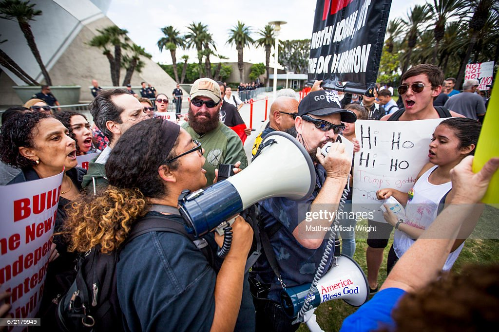 Protestors and police clash at a Trump rally. : Stock Photo
