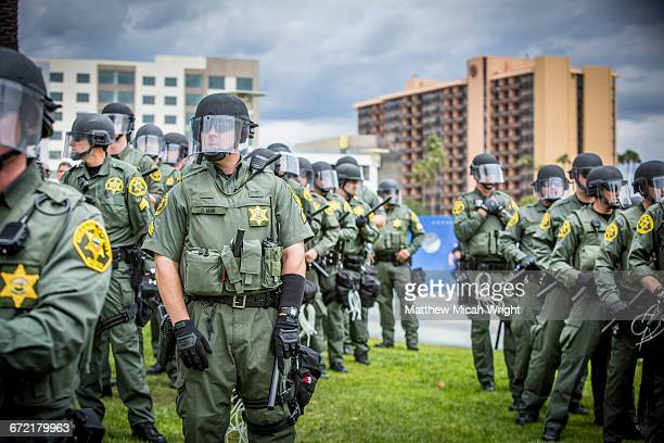Protestors and police presence at a Trump rally.