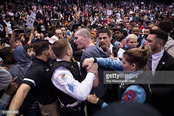 Protestors and Trump supporters clash after an event was postponed where republican presidential candidate Donald Trump was to speak at the...