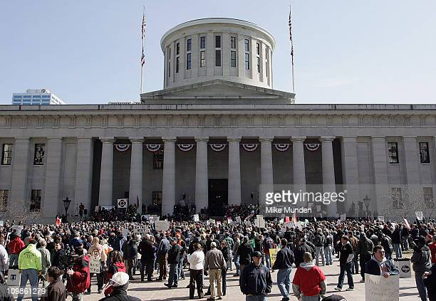 Protestors and union supporters gather as Ohio Gov. John Kasich delivers the State of the State address at Ohio Statehouse on March 8, 2011 in...