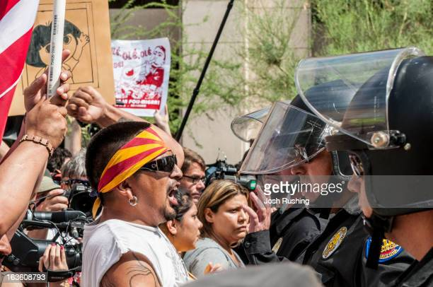 CONTENT] Protestors angry about SB1070 confront police in downtown Phoenix Ariz July 29 2010