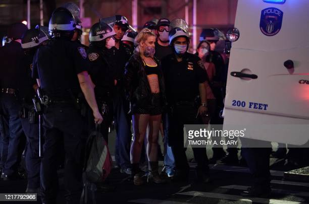 TOPSHOT Protestors are arrested on Park Avenue in New York City June 5 2020 as they defy the 8pm curfew while protesting the death of George Floyd...