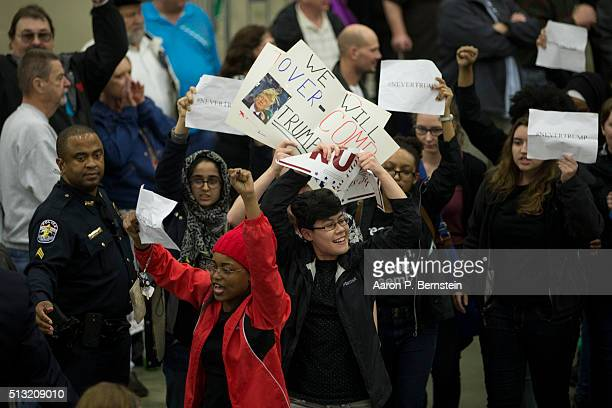 Protestors are led out as Republican presidential candidate Donald Trump speaks at the Kentucky International Convention Center March 1 2016 in...