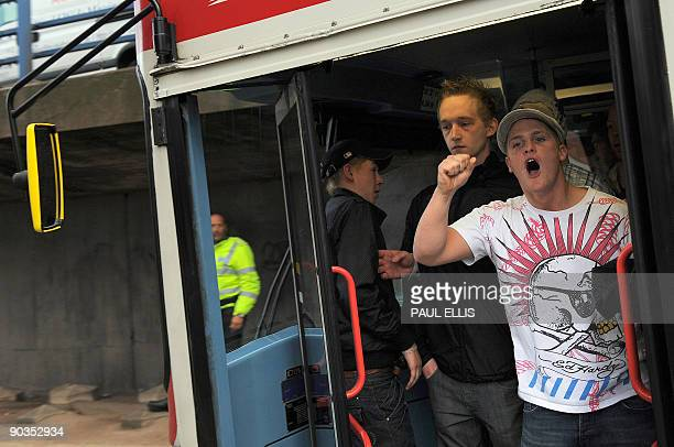 Protestors are moved by police officers during a demonstration organised by the English Defence League after they clashed with antifascists...
