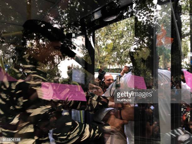Protestors are pulled into a bus by security officials as Indian Youth Congress staged a protest demanding an apology for what it termed as...