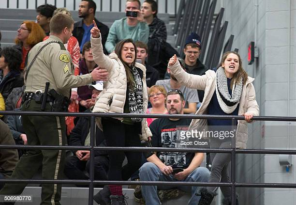 Protestors are removed after interupting Republican presidential candidate Donald Trump at a rally on January 26 2016 in Marshalltown Iowa Sheriff...