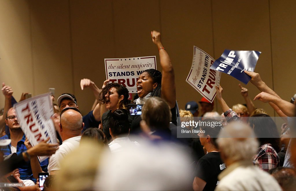 Protestors are removed from the Tampa Convention Center as Republican presidential candidate Donald Trump speaks to supporters during a town hall meeting on March 14, 2016 at in Tampa , Florida. Trump is campaigning ahead of the Florida primary on March 15.