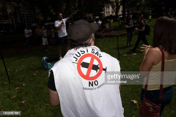 Protestors are seen at an anti-vaccination rally that started in Hyde Park on February 20, 2021 in Sydney, Australia. The protestors are...