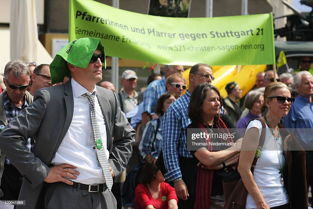 Protestors are seen during the conferece between the conflicting parties in the Stuttgart 21 railway station project on July 29, 2011 in Stuttgart, Germany. Heiner Geissler presents the results of the so called stress test, a computer based simulation of the capacity of the new railwaystation. The Stuttgart 21 project will replace the city's current terminal train station with a more efficient underground station and allow the creation of a new residential and office district in the city center. Thousands of irate activists oppose the project, citing the high cost, environmental impact and uncertain technical aspects.