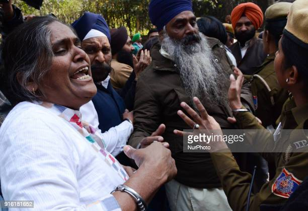 Protestors are stopped by Delhi police officials as they protest to demand arrest of Congress leader Jagdish Tytler for his alleged involvement in...