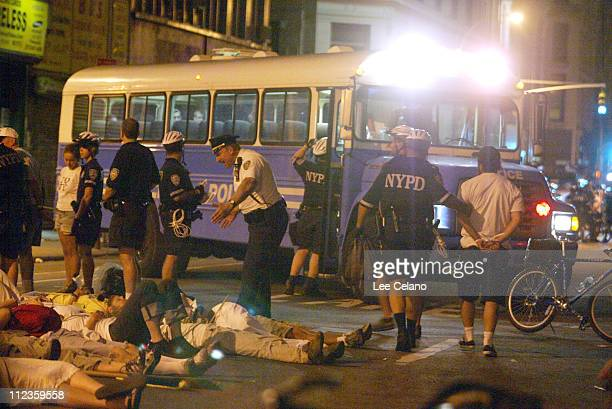 Protestors are taken into custody after participating in a diein near the Republican National Convention in New York City on August 31 2004