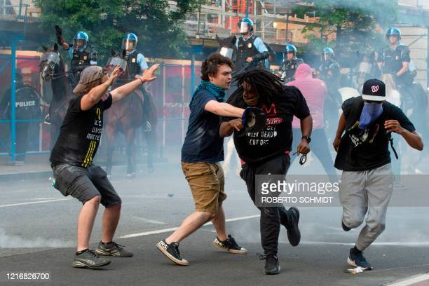 Protestors are tear gassed as the police disperse them near the White House on June 1 2020 as demonstrations against George Floyd's death continue...