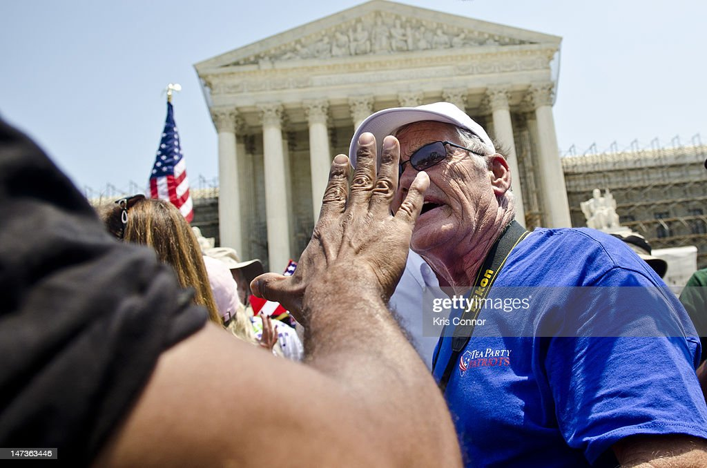 Protestors argue about the Affordable Healthcare Act outside the U.S. Supreme Court on June 28, 2012 in Washington, DC. The Court found the law to be constitutional and did not strike down any part of it.