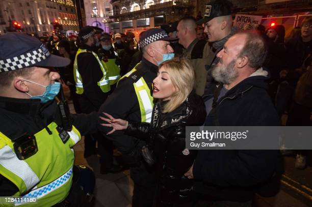 Protestors argue with Police near Piccadilly Circus during an Anonymous protest on November 5, 2020 in London, England. Decentralised, Leaderless,...