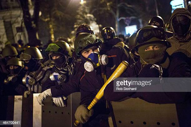 Protestors armed with shields and crude weapons including sticks and chains gather on Instytutska Street on January 24 2014 in Kiev Ukraine Talks to...