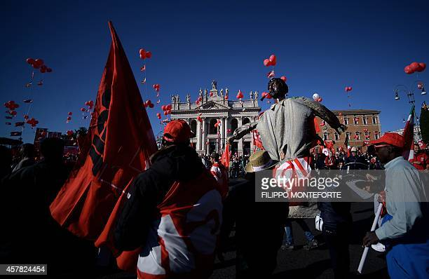 Protestors arrive in San Giovanni square during a demonstration organised by Italian General Confederation of Labour union on October 25 2014 in...