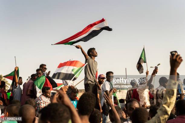 Protestors arrive in the main gathering point to protest against the military junta on April 27, 2019 in Khartoum, Sudan. After months of protesting...