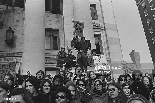 Protestors at a rally for Black Panthers hold signs stating 'Free the Panthers Now' New Haven CT November 1969