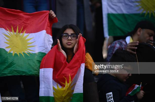 Protestors attend a demonstration against the Turkish military operation in northern Syria October 12 2019 in New York City