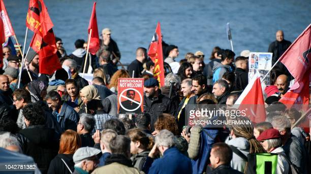 Protestors attend a demonstration called Erdogan not welcome on the banks of the river Rhine in Cologne prior to the visit of the Turkish President...