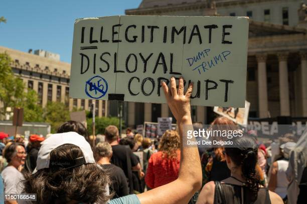 Protestors attend a demonstration calling for the impeachment of US President Donald Trump on June 15 2019 in New York City Major cities across the...