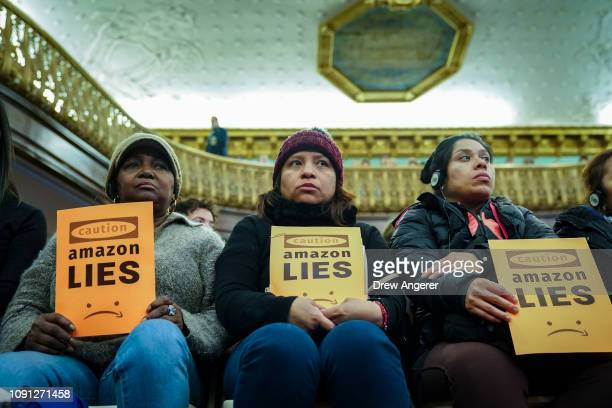 Protestors attend a New York City Council Finance Committee hearing titled 'Amazon HQ2 Stage 2 Does the Amazon Deal Deliver for New York City...