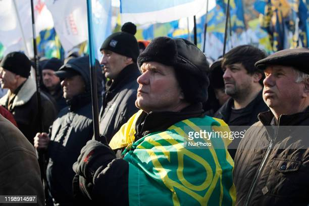 Protestors attend a rally against land reform and land sales, near the Ukrainian Parliament in Kyiv, Ukraine, on 06 February, 2020. The protestors...