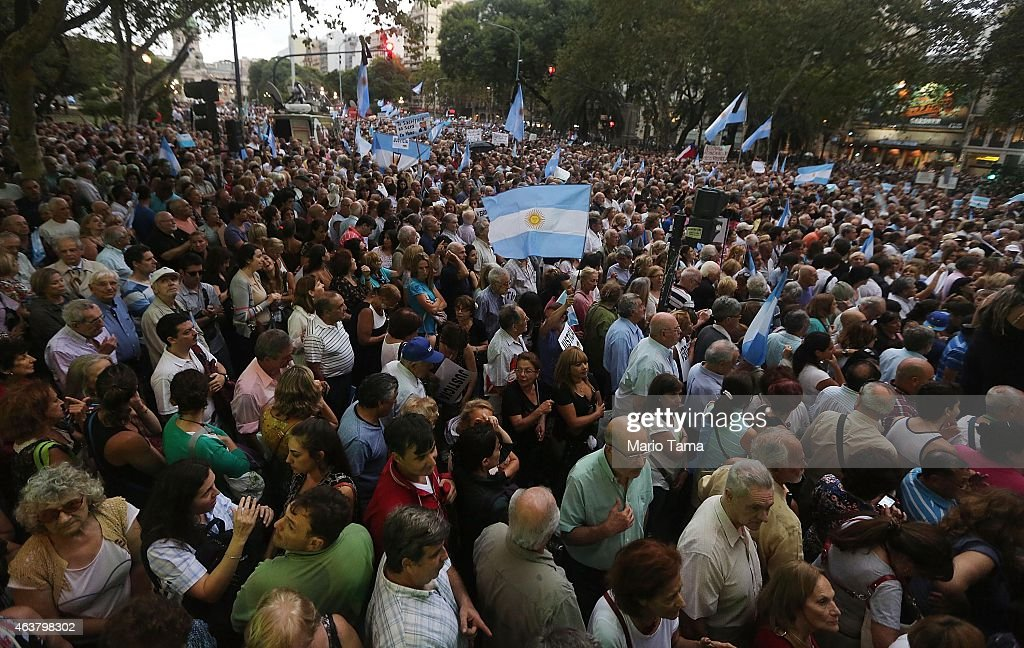 Protestors attend a 'Silent March' marking the one-month anniversary of the suspicious death of special prosecutor Alberto Nisman on February 18, 2015 in Buenos Aires, Argentina. Nisman was discovered dead with a gunshot wound shortly before he was scheduled to present accusations against President Cristina Fernandez de Kirchner.