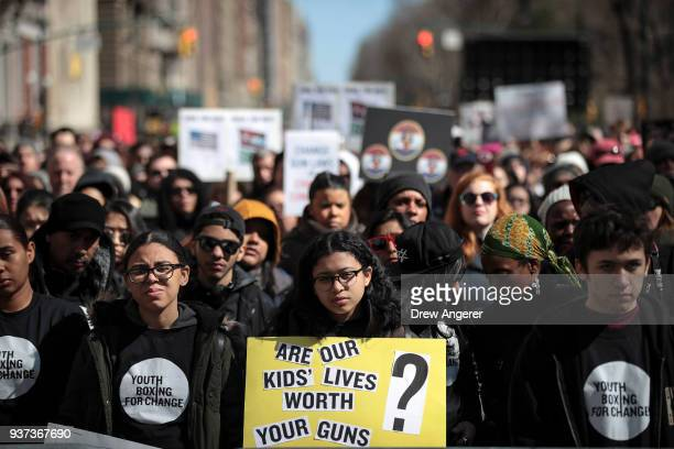 Protestors attend the March For Our Lives just north of Columbus Circle March 24 2018 in New York City Thousands of demonstrators including students...