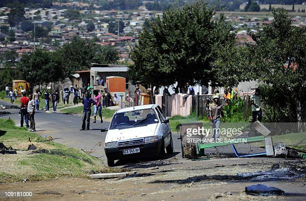 Protestors barricad streets as they demonstrate over poor government services on February 16 in Wesselton township outside of Ermelo around 200...