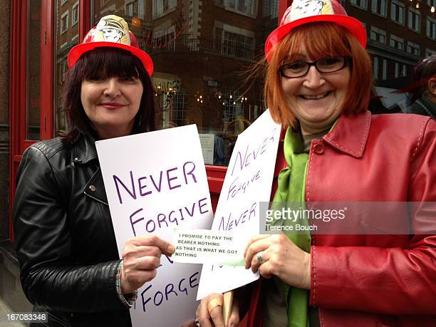 Protestors Bernadette Kavanagh from South London and Jennifer Gallacher from Orpington in Kent, wearing plastic miner hats and carrying small buckets...