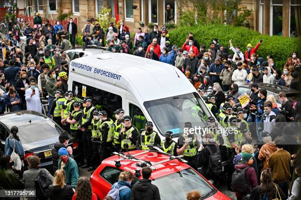 Protestors block a UK Home Office van to stop it from leaving Kenmure Street in First Minister Nicola Sturgeon's constituency on May 13, 2021 in...